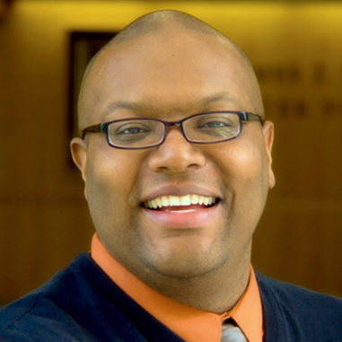 indoor headshot of Derrick Fox, member of the Digital Library Advisory Board